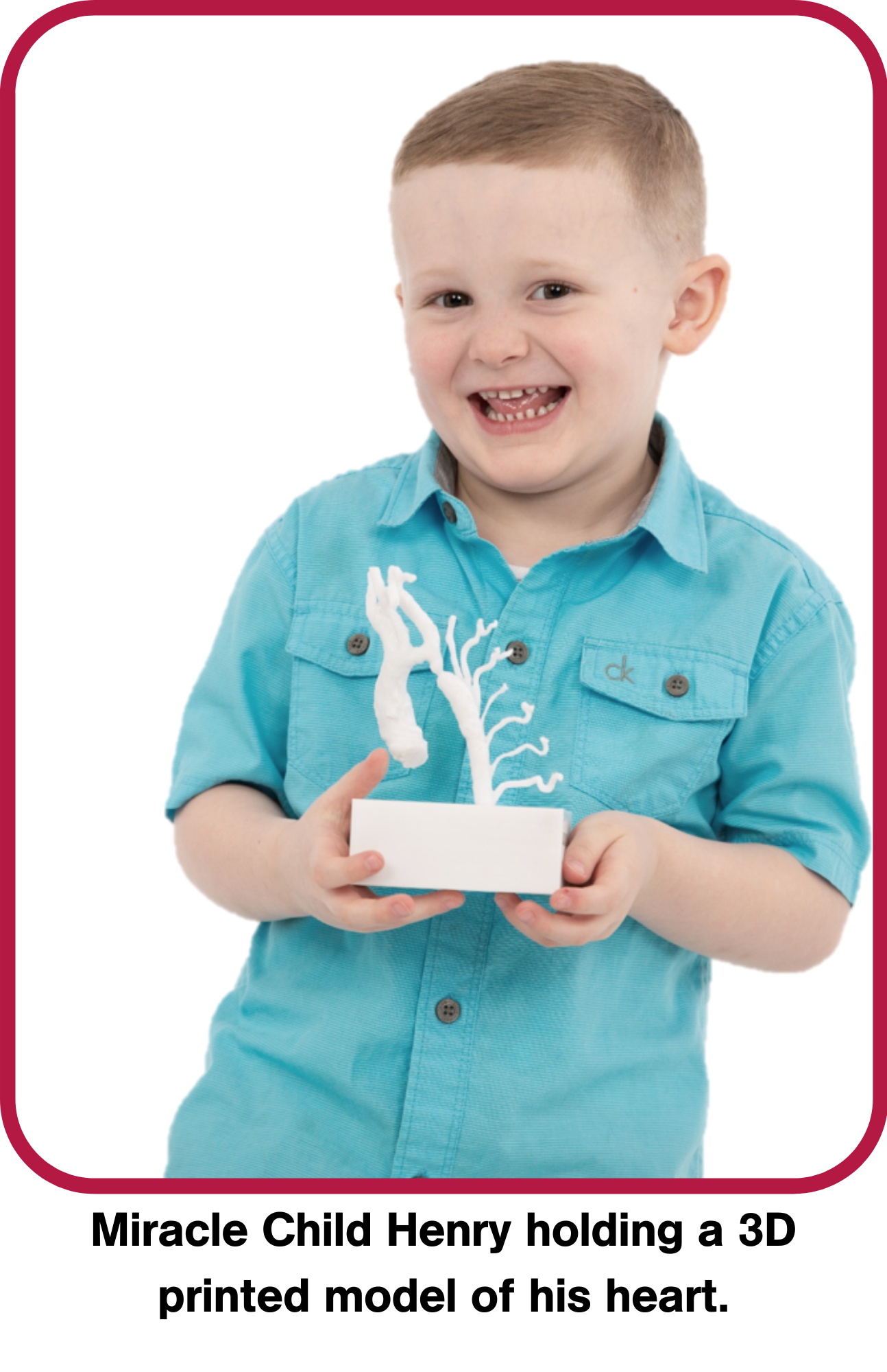 Miracle Child Henry holding a 3D model of his heart.