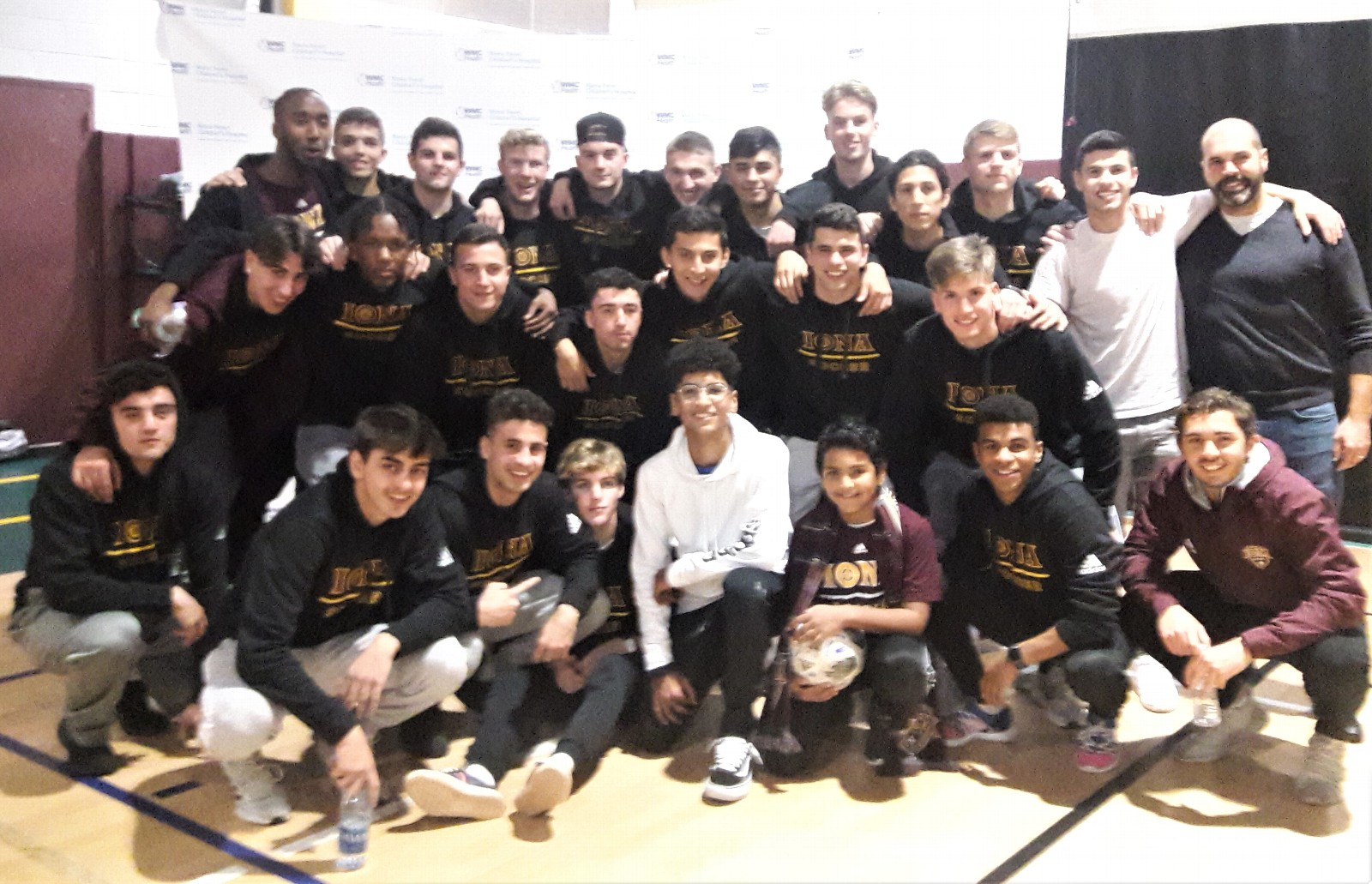 Kiran is pictured with the Iona College soccer team in 2019.