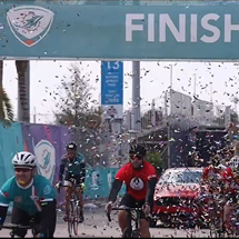 Riders celebrating across the finish line