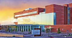 UNM Comprehensive Cancer Center facility at sunset