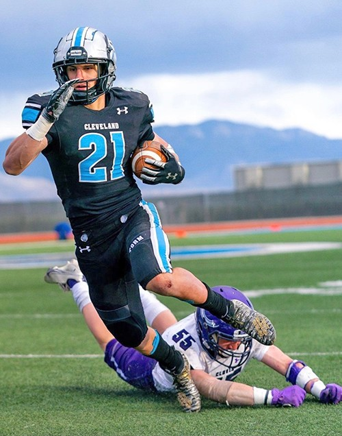 Tyler Jenson plays football with Cleveland High School, Rio Rancho