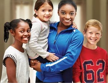 Simone Biles with kids