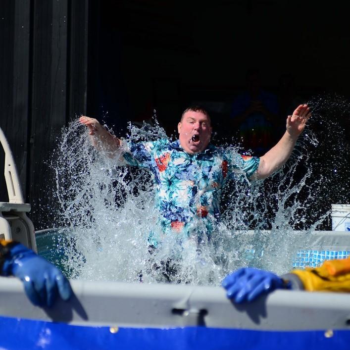 Man splashing water in a pool